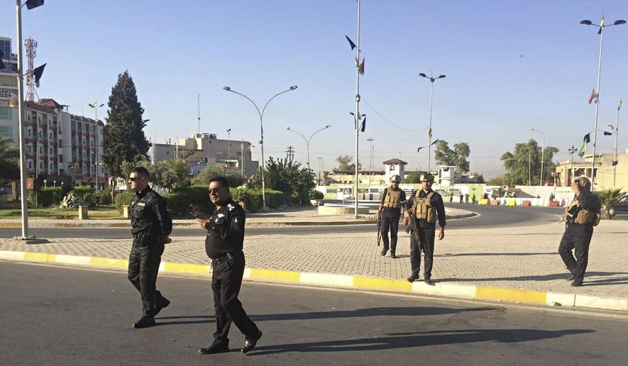 """Local police are deployed in Kirkuk, 290 kilometers (180 miles) north of Baghdad, Iraq, Monday, Oct. 16, 2017.  Iraqi Kurdish officials said early Monday that federal forces and state-backed militias have launched a """"major, multi-pronged"""" attack aimed at retaking the disputed northern city of Kirkuk, causing """"lots of casualties"""" in fighting south of the city.  (AP Photo/Emad Matti)"""