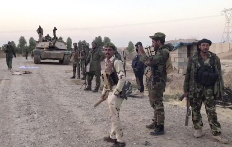 Iraqi troops entered disputed territories occupied by the nation's Kurds three years after Kurdish militias seized the areas outside their autonomous region to defend against an advance by the Islamic State extremist group. (Associated Press)