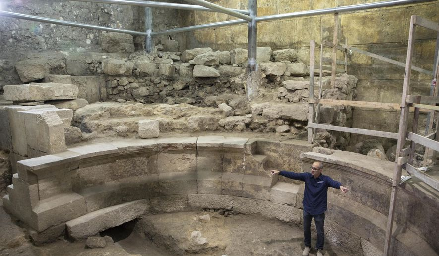 Israel's Antiquities Authority's  Joe Uziel stands in an ancient Roman theater-like structure in the Western Wall tunnels in Jerusalem's old city, Monday, Oct. 16, 2017. Israeli archaeologists have announced the discovery of the first known Roman-era theater in Jerusalem's Old City, a unique 1,800-year-old structure abutting the Western Wall that is believed to have been built during Roman Emperor Hadrian's reign. (AP Photo/Sebastian Scheiner)
