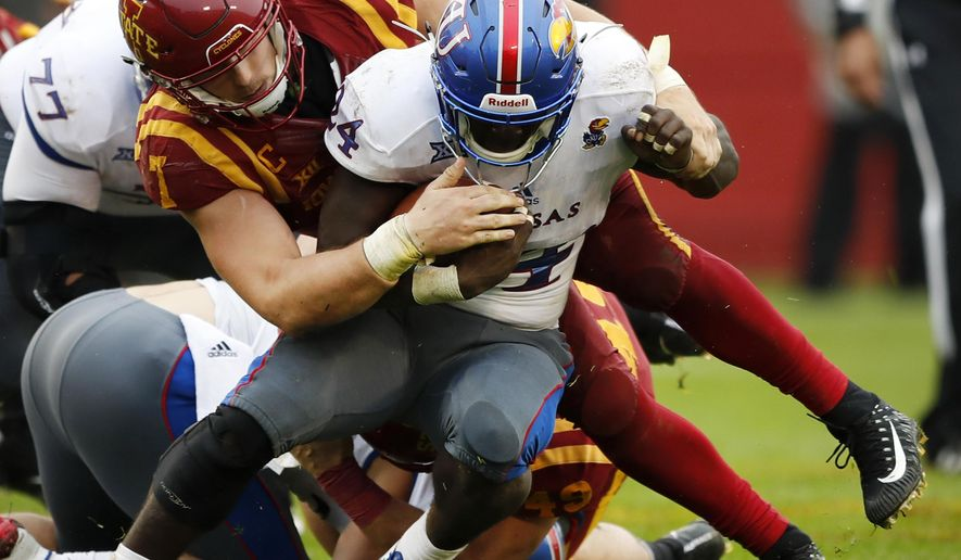 Kansas running back Taylor Martin (23) is tackled by Iowa State linebacker Joel Lanning (7) during the second half of an NCAA college football game, Saturday, Oct. 14, 2017, in Ames, Iowa. Iowa State won 45-0. (AP Photo/Charlie Neibergall)