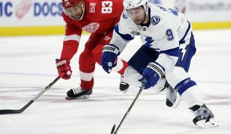 Tampa Bay Lightning center Tyler Johnson (9) drives down the ice past Detroit Red Wings defenseman Trevor Daley (83) for an unassisted goal during the first period of an NHL hockey game Monday, Oct. 16, 2017, in Detroit. (AP Photo/Duane Burleson)