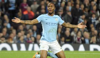 FILE - In this Tuesday, Sept. 26, 2017 file photo, Manchester City's Raheem Sterling gestures during the Champions League Group F soccer match between Manchester City and Shakhtar Donetsk at Etihad stadium, Manchester, England. Manchester City winger Raheem Sterling has stopped checking his social media accounts because of the abuse he gets from critics. (AP Photo/Rui Vieira, File)