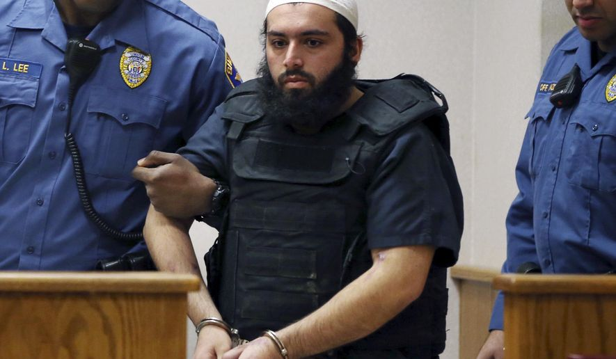 FILE - In this file photo from Tuesday, Dec. 20, 2016, Ahmad Khan Rahimi, the man accused of setting off bombs in New Jersey and New York in September is led into court in Elizabeth, N.J. Prosecutors said the case against Rahimi relies on video from security cameras in storefronts and businesses all over New Jersey and New York. (AP Photo/Mel Evans, File)