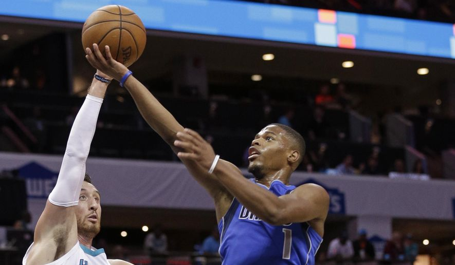 Dallas Mavericks' Dennis Smith Jr. (1) drives between Charlotte Hornets' Frank Kaminsky (44) and Kemba Walker (15) in the second half of a preseason NBA basketball game in Charlotte, N.C., Friday, Oct. 13, 2017. (AP Photo/Chuck Burton) **FILE**