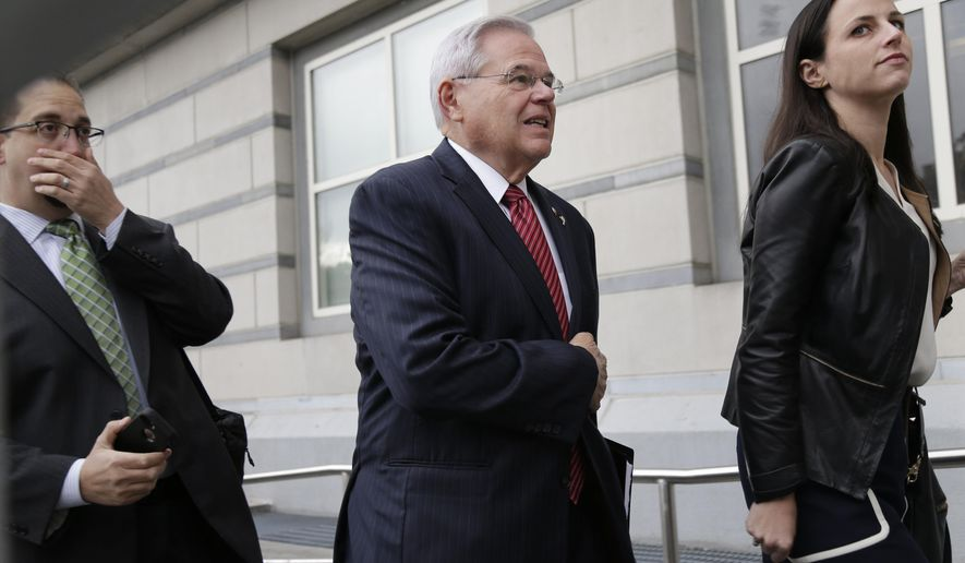 "U.S. Senator Robert Menendez, center, arrives to court in Newark, N.J., Monday, Oct. 16, 2017. The judge in Menendez's corruption trial could rule on Monday to dismiss the bulk of the indictment against the New Jersey Democrat, a decision that prosecutors say could ""broadly legalize pay-to-play politics."" (AP Photo/Seth Wenig)"