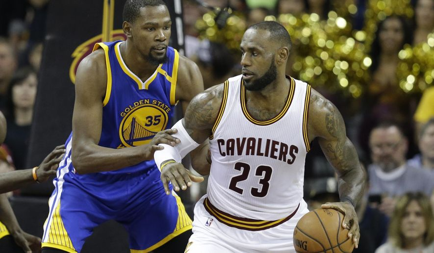 FILE - In this June 7, 2017, file photo, Golden State Warriors forward Kevin Durant (35) defends Cleveland Cavaliers forward LeBron James (23) during the second half of Game 3 of basketball's NBA Finals in Cleveland. The Warriors and Cavaliers are being penciled in to meet in the NBA Finals once again. (AP Photo/Tony Dejak, File)