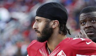Former San Francisco 49ers quarterback Colin Kaepernick stands on the sideline during an NFL football game in Santa Clara, California, in 2016. (AP Photo/Tony Avelar) ** FILE **