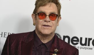 "FILE - In this March 25, 2017 file photo, Elton John arrives at Elton John's 70th Birthday and 50-Year Songwriting Partnership with Bernie Taupin celebration in Los Angeles. John announced Monday, Oct. 16, 2017, that his show, ""The Million Dollar Piano"" at Caesars Palace in Las Vegas will be ending in May 2018 after more than 200 performances. (Photo by Jordan Strauss/Invision/AP, File)"