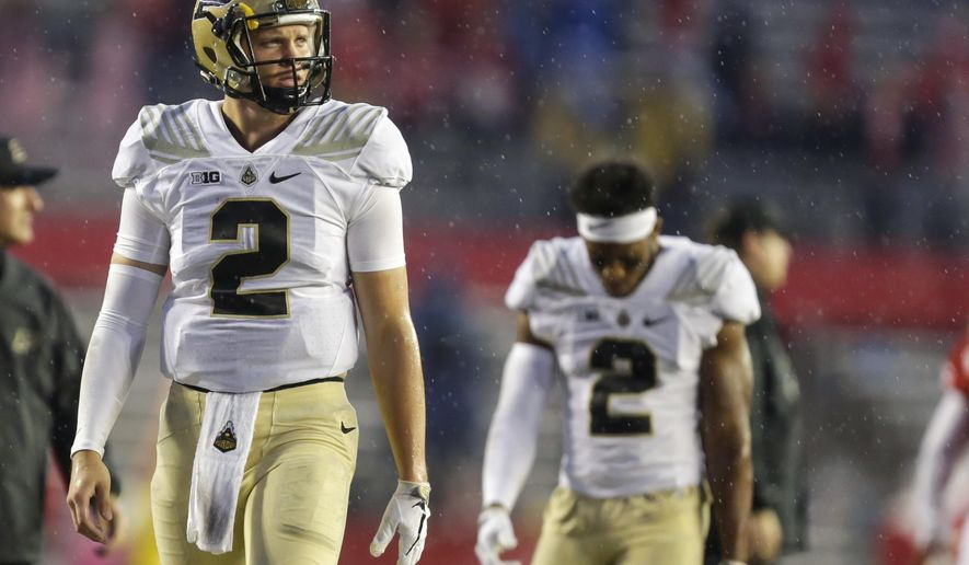 Purdue quarterback Elijah Sindelar, left, and Da'Wan Hunte walk off the field after Purdue 17-9 loss to Wisconsin in an NCAA college football game, Saturday, Oct. 14, 2017, in Madison, Wis. (AP Photo/Andy Manis)