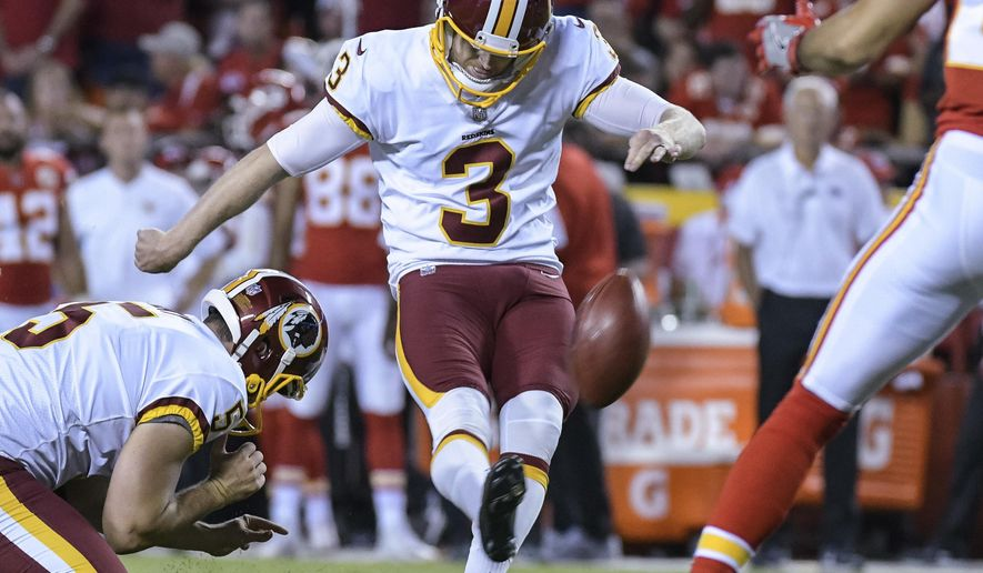 This photo taken Oct. 2, 2017, shows Washington Redskins kicker Dustin Hopkins (3) kicking a point-after during the second half of an NFL football game in Kansas City, Mo. (AP Photo/Reed Hoffmann)