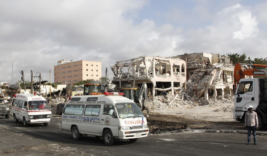 Ambulances carrying wounded victims passes the scene of Saturday's truck bomb blast, as they head to airport to be airlifted by Turkish air ambulance for treatment in Turkey, in Mogadishu, Somalia, Monday, Oct, 16, 2017. The death toll from Saturday's truck bombing in Somalia's capital now exceeds 300, the director of an ambulance service said Monday, as the country reeled from the deadliest single attack. (AP Photo/Farah Abdi Warsameh)