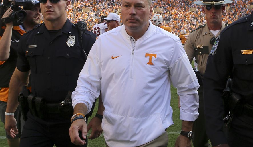 Tennessee head coach Butch Jones makes his way off the field following the Volunteers' 15-9 loss against South Carolina in an NCAA college football game at Neyland Stadium, Saturday, Oct. 14, in Knoxville, Tenn. (C.B. Schmelter/Chattanooga Times Free Press via AP)