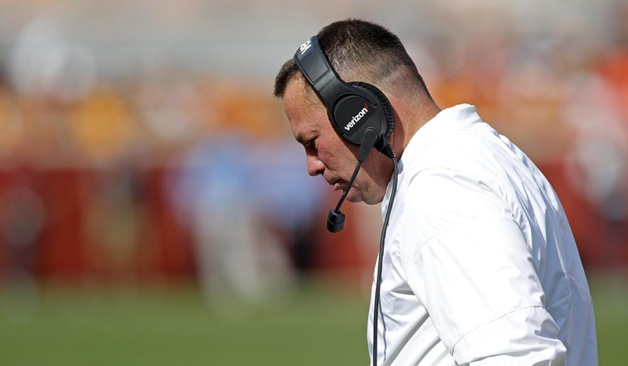 Tennessee head coach Butch Jones walks back to the sideline in the second half of an NCAA college football game against South Carolina Saturday, Oct. 14, 2017, in Knoxville, Tenn. South Carolina won 15-9. (AP Photo/Wade Payne)