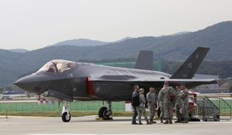 A U.S. F-35 stealth fighter is seen during the press day of the 2017 Seoul International Aerospace and Defense Exhibition at Seoul Airport in Seongnam, South Korea, Monday, Oct. 16, 2017. South Korean and U.S. troops launched five days of naval drills on Monday, three days after North Korea renewed its threat to fire missiles near the American territory of Guam. (AP Photo/Ahn Young-joon)