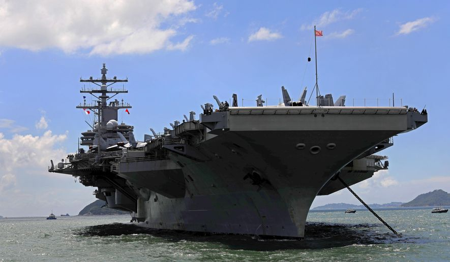 FILE - In this Oct. 2, 2017 file photo, USS Ronald Reagan aircraft carrier arrives in Hong Kong. South Korean and U.S. troops launched five days of naval drills on Monday, Oct. 16, 2017, three days after North Korea renewed its threat to fire missiles near the American territory of Guam. (AP Photo/Vincent Yu, File)