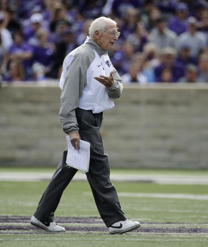 Kansas State head coach Bill Snyder talks to game officials during the first half of an NCAA college football game against TCU, Saturday, Oct. 14, 2017, in Manhattan, Kan. (AP Photo/Charlie Riedel)