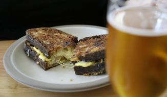 In this photo taken Friday, Aug. 11, 2017, is a grilled sandwich made with freshly baked bread at the Tartine Manufactory in San Francisco. For a bread lover, no destination is more alluring than San Francisco. (AP Photo/Eric Risberg)