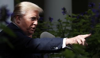 President Donald Trump points to a reporter to ask a question during a media availability in the Rose Garden with Senate Majority Leader Mitch McConnell of Ky., after their meeting at the White House, Monday, Oct. 16, 2017, in Washington. (AP Photo/Alex Brandon)