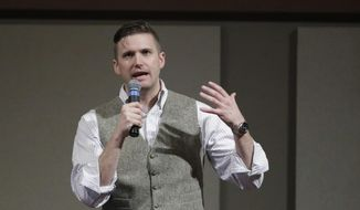 In this Dec. 6, 2016, file photo, Richard Spencer, who leads a movement that mixes racism, white nationalism and populism, speaks at the Texas A&M University campus in College Station, Texas. (AP Photo/David J. Phillip, File)