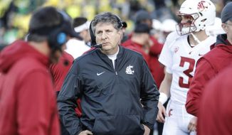 Washington State head coach Mike Leach works the sidelines against Oregon in an NCAA college football game Saturday, Oct. 7, 2017 in Eugene, Ore. (AP Photo/Thomas Boyd)