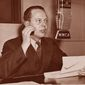 William Dodd Jr. speaks on the radio during debate within the United States on whether to enter World War II. International News Service photo.