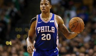 FILE - In this Oct. 9, 2017, file photo, Philadelphia 76ers' Markelle Fultz brings the ball up the court during the second quarter of a preseason NBA basketball game against the Boston Celtics in Boston. Joel Embiid is again on a minutes restriction. No. 1 pick Markelle Fultz won't start. Nothing ever goes as planned for the Philadelphia 76ers as they head into season opener against Washington on Wednesday. (AP Photo/Winslow Townson, File)