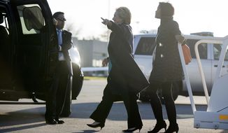 "Democratic presidential candidate Hillary Clinton, center, accompanied by long time aide Cheryl Mills, right, arrives at Cleveland Burke Lakefront Airport in Cleveland, Sunday, Nov. 6, 2016. FBI Director James Comey tells Congress in a Nov. 6 letter, that a review of new Hillary Clinton emails has ""not changed our conclusions"" from earlier this year that she should not face charges. (AP Photo/Andrew Harnik)"