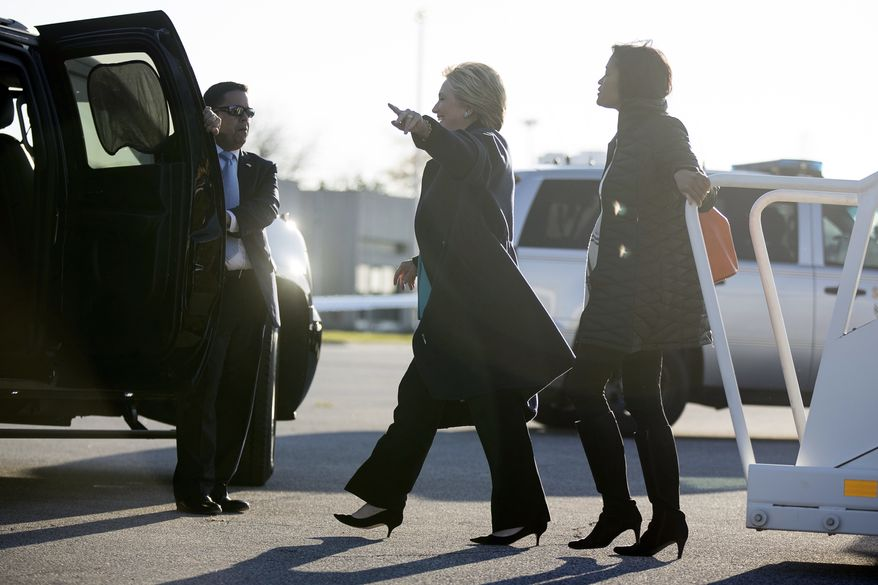 """Democratic presidential candidate Hillary Clinton, center, accompanied by long time aide Cheryl Mills, right, arrives at Cleveland Burke Lakefront Airport in Cleveland, Sunday, Nov. 6, 2016. FBI Director James Comey tells Congress in a Nov. 6 letter, that a review of new Hillary Clinton emails has """"not changed our conclusions"""" from earlier this year that she should not face charges. (AP Photo/Andrew Harnik)"""