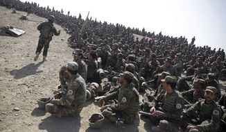 Afghan National Amy soldiers sit during a military exercise in Kabul, Afghanistan, Tuesday, Oct. 17, 2017. (AP Photo/Massoud Hossaini)