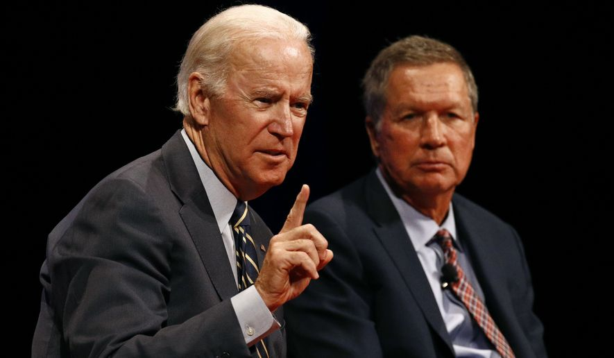 Former Vice President Joseph R. Biden (left) and Ohio Gov. John Kasich participated in a discussion on bridging political and partisan divides at the University of Delaware in Newark on Tuesday. (Associated Press)