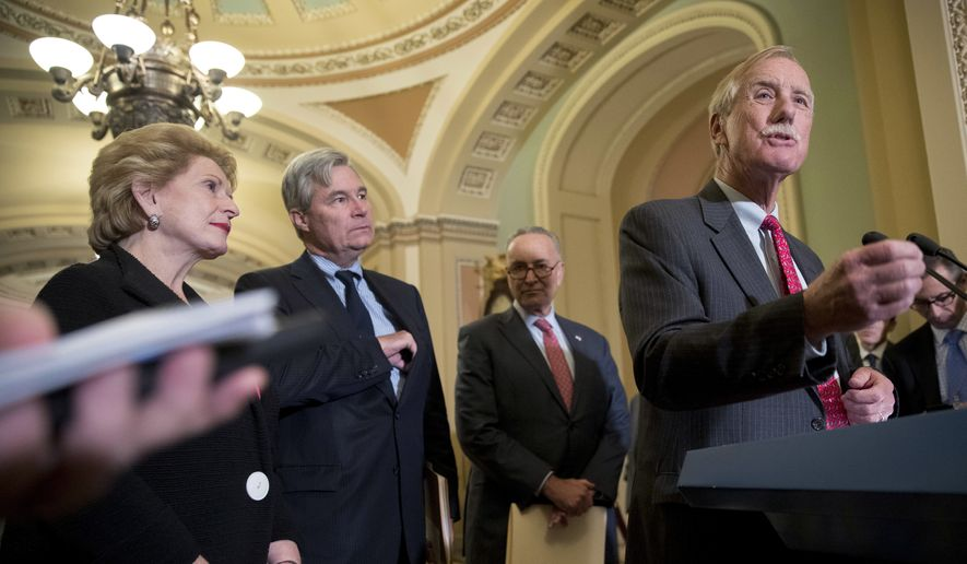 Sen. Angus King (right), Maine independent, accompanied by (from left) Democratic Sens. Debbie Stabenow of Michigan, Sheldon Whitehouse of Rhode Island and Senate Minority Leader Chuck Schumer of New York, speaks to reporters on Capitol Hill in Washington on Oct. 17, 2017, following Senate policy luncheons. (Associated Press) **FILE**