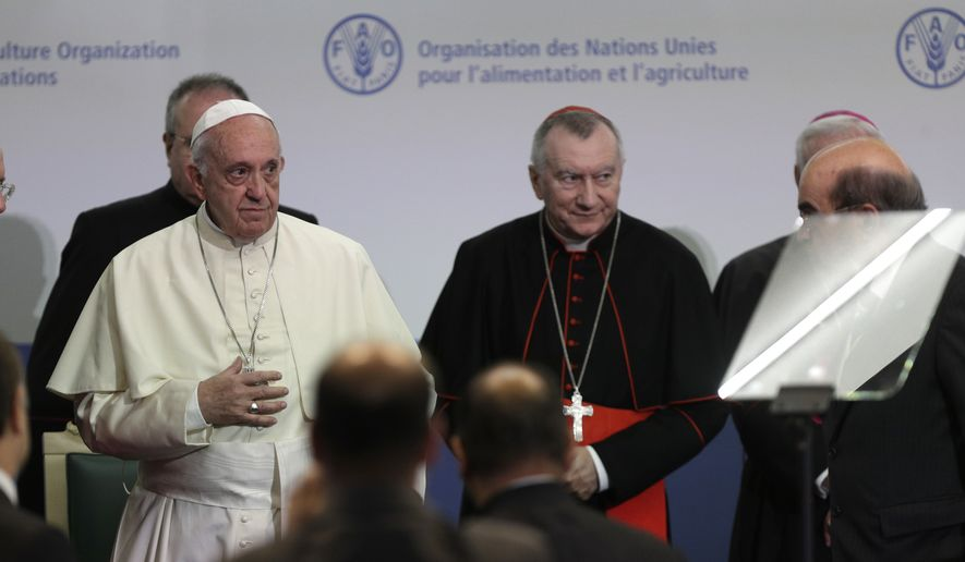 Pope Francis acknowledges the applause of the audience after he delivered his speech during the visit to the United Nations Food and Agriculture Organization (FAO) on the occasion of the World Food Day, Monday, Oct. 16, 2017.(AP Photo/Andrew Medichini)
