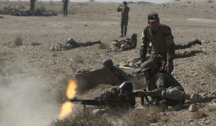 Afghan National Amy commandos open fire during a military exercise in Kabul, Afghanistan, Tuesday, Oct. 17, 2017. (AP Photo/Massoud Hossaini)