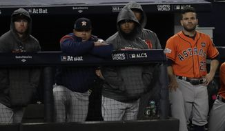 Houston Astros' Jose Altuve watches from the dugout during the ninth inning of Game 4 of baseball's American League Championship Series against the New York Yankees Tuesday, Oct. 17, 2017, in New York. (AP Photo/David J. Phillip)