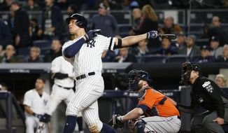 New York Yankees' Aaron Judge hits a home run during the seventh inning of Game 4 of baseball's American League Championship Series against the Houston Astros Tuesday, Oct. 17, 2017, in New York. (AP Photo/Kathy Willens)