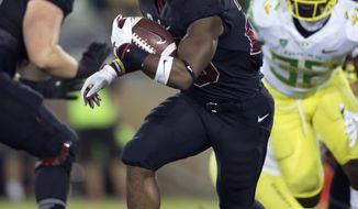 File-This Oct. 14, 2017, file photo shows Stanford's Bryce Love (20) breaking free for a 30-yard gain against Oregon during the first quarter of an NCAA college football game, in Stanford, Calif. (AP Photo/D. Ross Cameron, File)