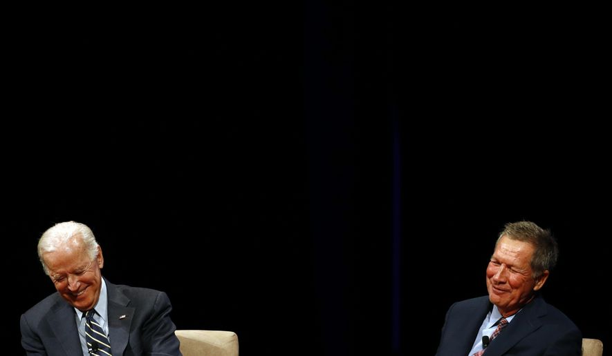 Former Vice President Joe Biden, left, and Ohio Gov. John Kasich laugh as they participate in a discussion on bridging political and partisan divides at the University of Delaware in Newark, Del., Tuesday, Oct. 17, 2017. (AP Photo/Patrick Semansky)