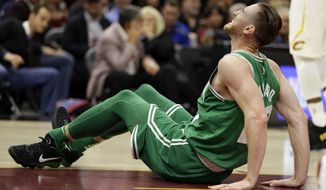 Boston Celtics' Gordon Hayward grimaces in pain in the first half of an NBA basketball game against the Cleveland Cavaliers, Tuesday, Oct. 17, 2017, in Cleveland. Hayward broke his left ankle on a play. (AP Photo/Tony Dejak)