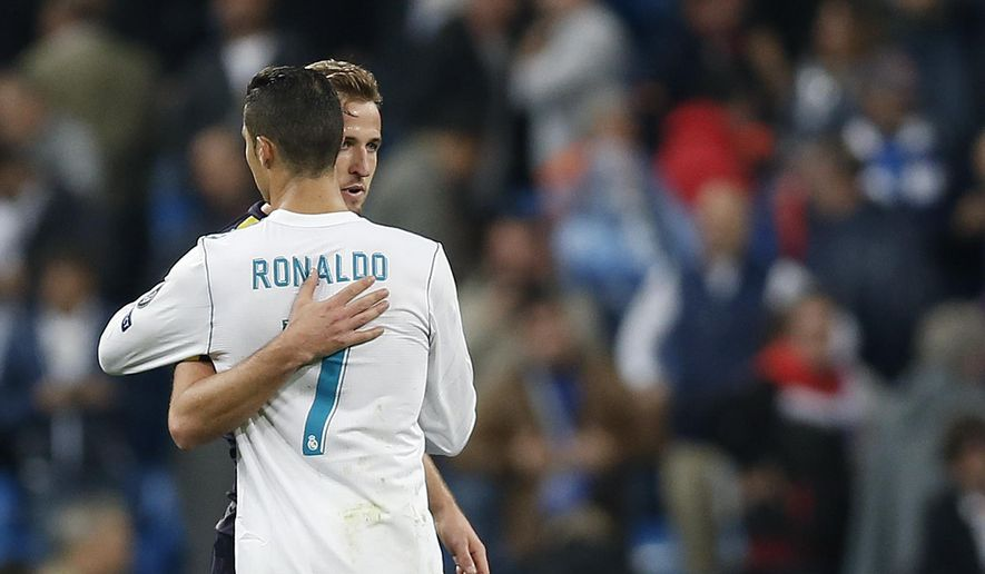 Tottenham's Harry Kane embraces Real Madrid's Cristiano Ronaldo after the end of the Group H Champions League soccer match between Real Madrid and Tottenham Hotspur at the Santiago Bernabeu stadium in Madrid, Tuesday, Oct. 17, 2017. The match ended 1-1. (AP Photo/Francisco Seco)