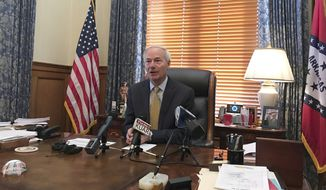 Arkansas Gov. Asa Hutchinson speaks to reporters at the State Capitol, Tuesday, Oct. 17, 2017 in Little Rock, Ark. Hutchinson spoke about an effort to put a highway funding initiative on next year's ballot. Hutchinson said he would vigorously oppose any measure that calls for tapping into general revenue for road needs. (AP Photo/Andrew DeMillo)