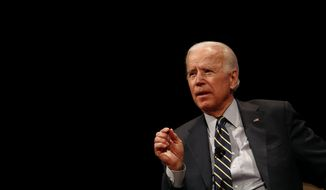 In this file photo, former Vice President Joe Biden participates in a discussion on bridging political and partisan divides with Ohio Gov. John Kasich at the University of Delaware in Newark, Del., Tuesday, Oct. 17, 2017. (AP Photo/Patrick Semansky) **FILE**