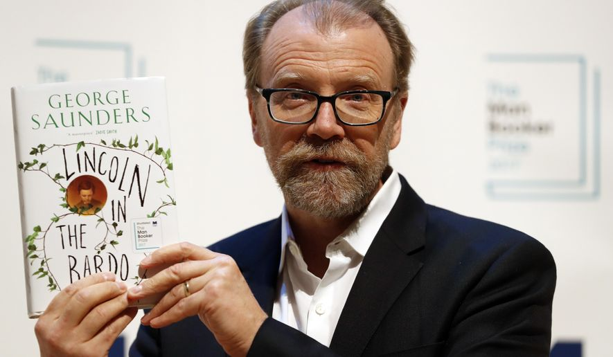 Author George Saunders of the United States with his book 'Lincoln in the Bardo' during a photocall with all six shortlisted authors of the 2017 Man Booker Prize for Fiction, in London, Monday, Oct. 16, 2017. The winner of the award will be announced Tuesday at a ceremony in London. (AP Photo/Kirsty Wigglesworth)