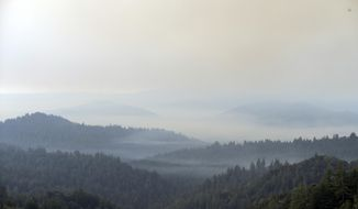 The Santa Cruz Mountains are covered in smoke from a wildfire Tuesday, Oct. 17, 2017, near Boulder Creek, Calif. (AP Photo/Marcio Jose Sanchez)