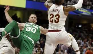 Boston Celtics' Gordon Hayward (20) falls as Cleveland Cavaliers' LeBron James (23) reaches for a loose ball in the first half of an NBA basketball game, Tuesday, Oct. 17, 2017, in Cleveland. Hayward broke his left ankle on a play. (AP Photo/Tony Dejak)