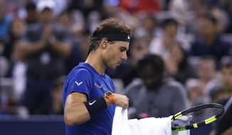 Rafael Nadal of Spain reacts during his men's singles final match against Roger Federer of Switzerland in the Shanghai Masters tennis tournament at Qizhong Forest Sports City Tennis Center in Shanghai, China, Sunday, Oct. 15, 2017. (AP Photo/Andy Wong)
