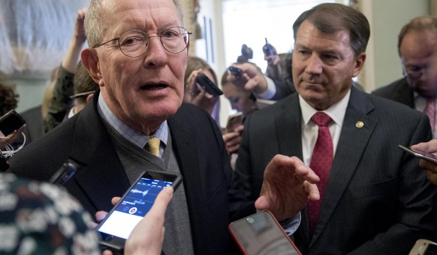 "Sen. Lamar Alexander, R-Tenn., left, accompanied by Sen. Mike Rounds, R-S.D., right, speaks to reporters on Capitol Hill in Washington, Tuesday, Oct. 17, 2017, after he and Sen. Patty Murray, D-Wash., say they have the ""basic outlines"" of a bipartisan deal to resume payments to health insurers that President Donald Trump has blocked. (AP Photo/Andrew Harnik)"