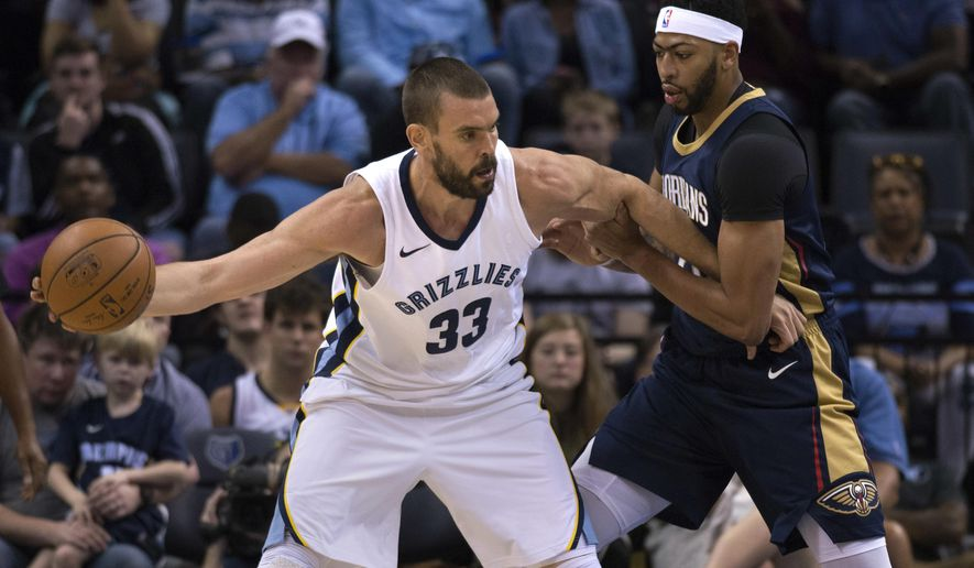 File-This Oct. 13, 2017, file photo shows Memphis Grizzlies center Marc Gasol (33) controlling  the ball against New Orleans Pelicans forward Anthony Davis during the first half of an NBA basketball preseason game in Memphis, Tenn. Gasol wanted a boat before the Memphis Grizzlies center settled for a Tesla. (AP Photo/Brandon Dill, File)