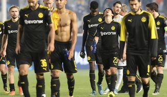 Dortmund players leave the pic after the Champions League Group H soccer match between APOEL Nicosia and Borussia Dortmund at GSP stadium, in Nicosia, Cyprus, on Tuesday, Oct. 17, 2017. (AP Photo/Petros Karadjias)