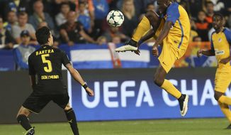 APOEL Nicosia's Mickael Pote controls a ball as Dortmund's Marc Bartra, left, looks on during the Champions League Group H soccer match between APOEL Nicosia and Borussia Dortmund at GSP stadium, in Nicosia, Cyprus, on Tuesday, Oct. 17, 2017. (AP Photo/Petros Karadjias)
