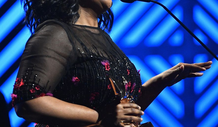 CeCe Winans wins Gospel Artist of the Year at the 2017 Gospel Music Association Dove Awards at Lipscomb University's Allen Arena Tuesday Oct. 17, 2017, in Nashville, Tenn.   (Larry McCormack/The Tennessean via AP)